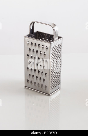 Box cheese grater on white background - Stock Photo