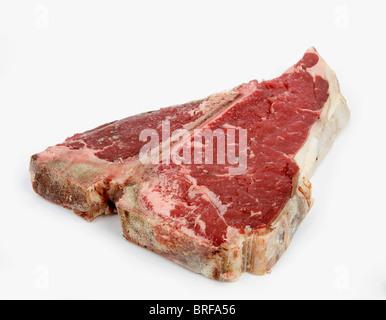 T-bone steak against white background - Stock Photo