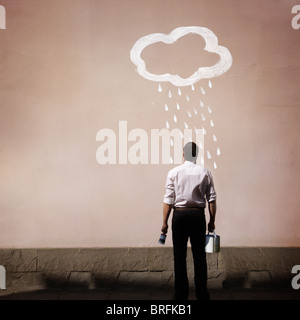 man with rain cloud painted on a wall - Stock Photo