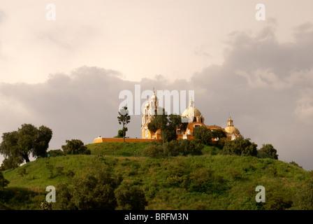 Santuario de Nuestra Senora de los Remedios church on top of Tepanapa Pyramid or Great Pyramid of Cholula, Cholula, - Stock Photo