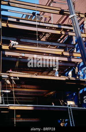 Highrise Building Construction Site with , tradesmen,, NYC - Stock Photo