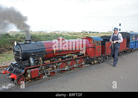 One-thirds scale steam locomotive 'Hercules' operating on the Romney, Hythe and Dymchurch railway, Dungeness, Kent, - Stock Photo