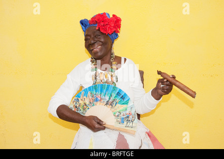 HAVANA: CUBAN WOMAN IN TRADITIONAL DRESS WITH CIGAR - Stock Photo