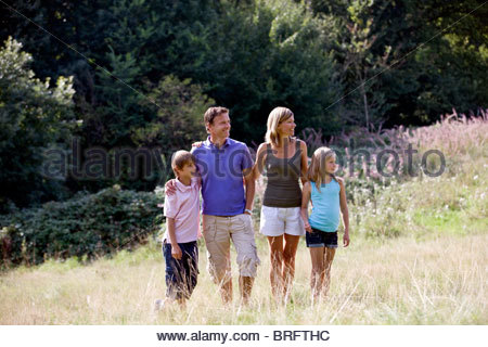 A family standing in a field - Stock Photo