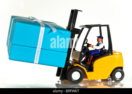A toy forklift truck delivering a wrapped present