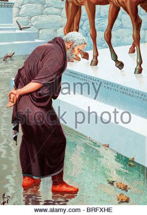 Herodotus, an ancient Greek historian, studies an inscription. - Stock Photo