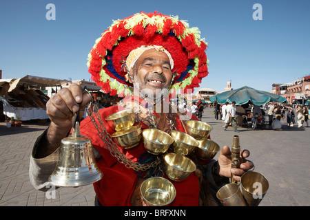 MARRAKESH: TRADITIONAL WATER SELLER IN DJEMAA EL FNA - Stock Photo