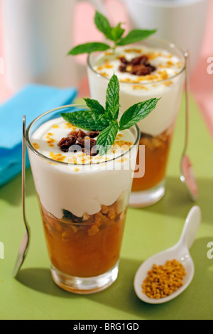 Yogurt with walnuts and pollen. Recipe available. - Stock Photo