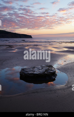 A spectacular colourful sunrise at Robin Hood's Bay, North Yorkshire - Stock Photo