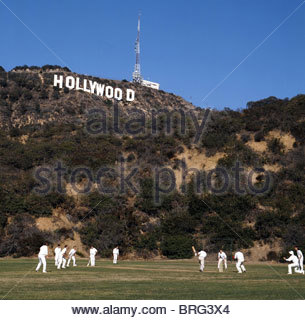 Amateur British cricket team playing under the famous Hollywood sign California USA - Stock Photo