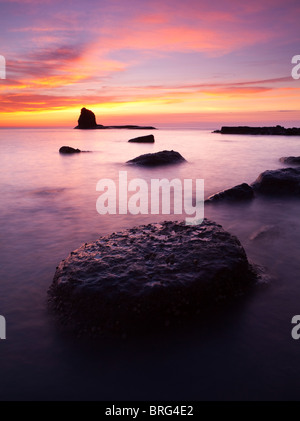 A spectacular colourful sunrise at Saltwick bay, North Yorkshire - Stock Photo