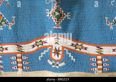 A Sioux woman's dress, circa 1900 A long leather dress with splendid bead work and hanging beaded leather thongs. - Stock Photo