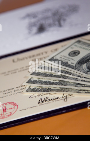 Money and diploma, tuition and fees for college degree - Stock Photo