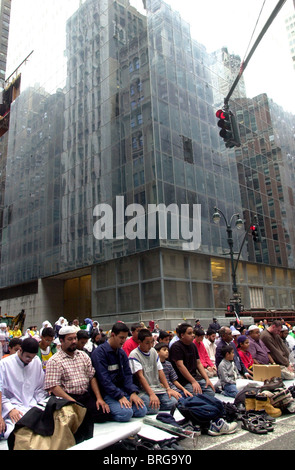 Muslims pray on Madison Ave. before marching in the 18th Annual Muslim Day Parade in New York - Stock Photo