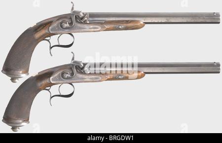 A cased pair of percussion pistols, N. Guyot, Paris, circa 1850. Octagonal blued barrels with patent breechblocks - Stock Photo
