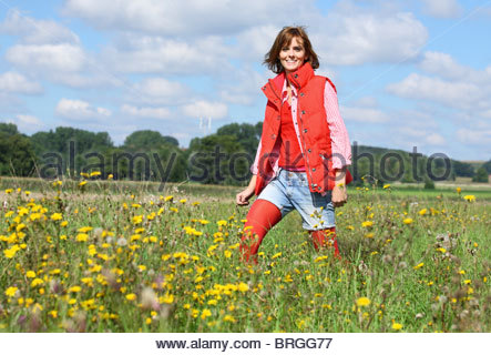 young brunette woman walking her dog - Stock Photo