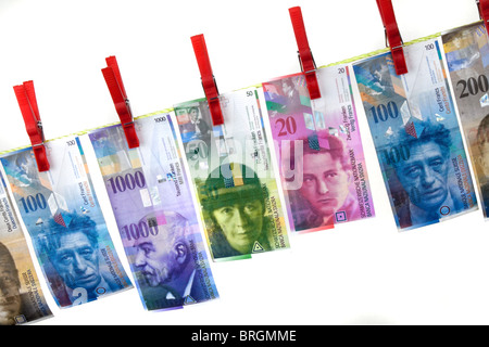Money Laundering By Swiss Franc On Clothesline Stock Photo