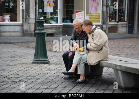 mature couple finding their way Maastricht Netherlands - Stock Photo