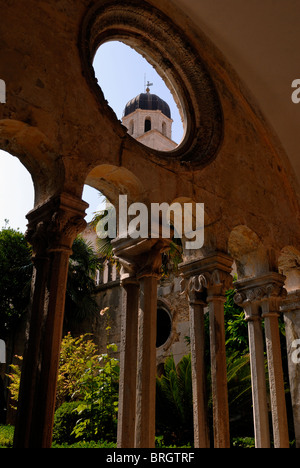 A fine view from Franciscan Cloister to the bell tower of the Franciscan Monastery. Construction of the Monastery - Stock Photo