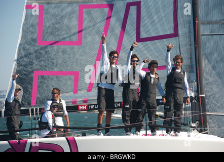 lucca lalli (l), skipper and his elated b-lin sailing team wins the world championship celebrate with various hand - Stock Photo
