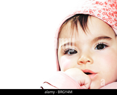 Little girl closeup portrait over white background - Stock Photo