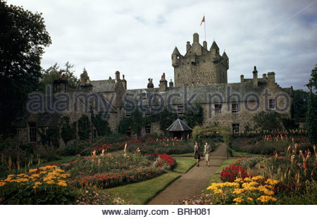 The Earl of Cawdor and his wife stroll through their garden. - Stock Photo