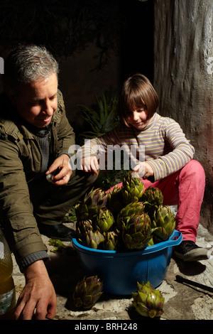©John Angerson Gabriel David prepares for the feast in San Giuseppe, in Scopello, Sicily. - Stock Photo