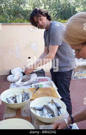 ©John Angerson Gabriel David prepares pasta con le sarde. - Stock Photo