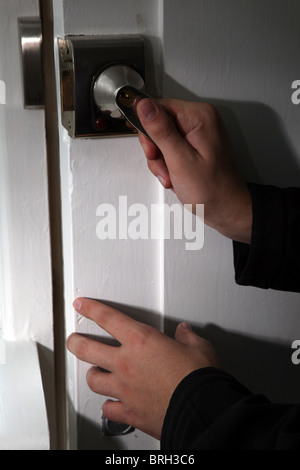 Male hands opening or closing a front door - Stock Photo