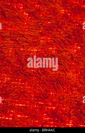 Red Towelling background with light showing through - Stock Photo