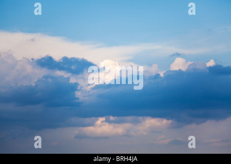 blue sky with fluffy white clouds on a sunny day - Stock Photo