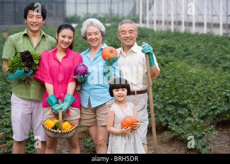 Three generation family in the garden - Stock Photo