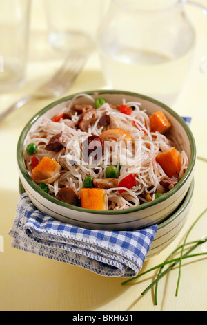 Rice noodles with crab and mushrooms. Recipe available. - Stock Photo