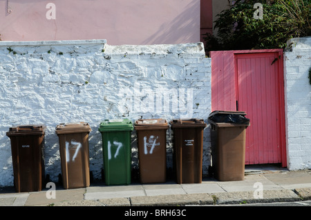 Line of Plymouth City Council's wheelie bins outside a residents back gate - Stock Photo