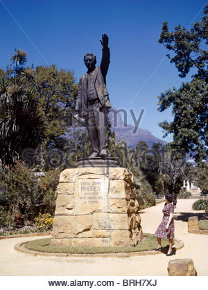 A woman looks up at a statue of Cecil John Rhodes. - Stock Photo