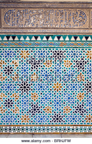 Detail of tiles and plaster carving at Alcazar Royal Palaces, Seville. - Stock Photo