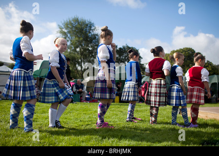 Young highland dancers are waiting for their turn at the Peebles highland games, Peebles, Scotland - Stock Photo