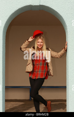 Woman Wearing Red Pillar Box Hat. Model Released - Stock Photo