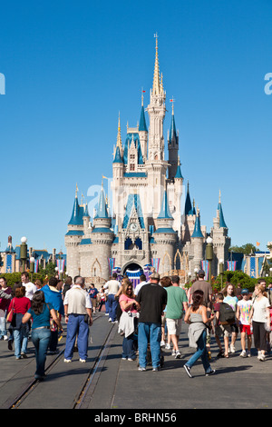 Park guests on a crowded Main Street in front of Cinderella's Castle in Walt Disney's Magic Kingdom theme park - Stock Photo
