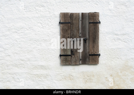 Old wooden and weathered window shutter on a fisherman's cottage, Scotland - Stock Photo