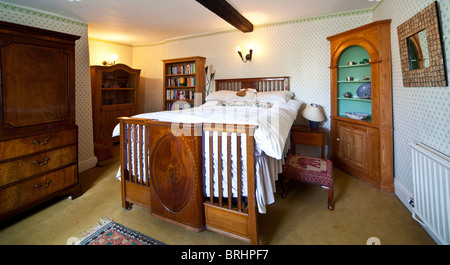 Guest or main bedroom in an English country house - Stock Photo
