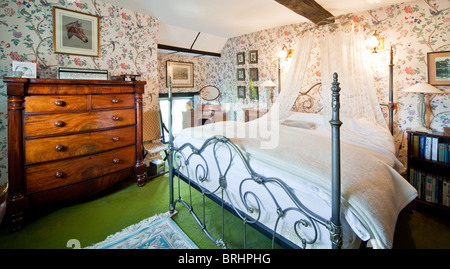 The master bedroom in an old English country house, the bed made by 'And So To Bed' - Stock Photo