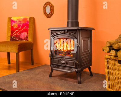 woodburning stove and a basket of logs stock photo royalty free image 36643595 alamy. Black Bedroom Furniture Sets. Home Design Ideas