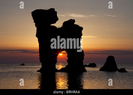 Eroded seastacks at Gamla Hamn at sunset in Fårö, Sweden - Stock Photo