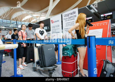Shanghai, China. Passengers waiting in queue at passport check in departure lounge, Pudong International Airport, - Stock Photo