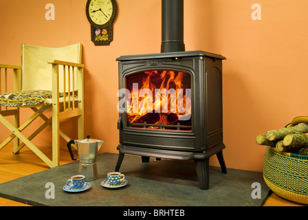A Franco Belge Savoy wood burning stove in a cosy interior - Stock Photo