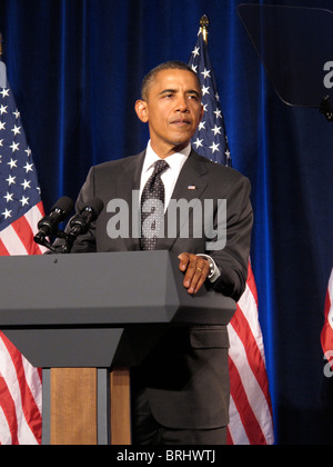 Portrait of US President Barack Obama with the Flag of The United States of America Behind Him - Stock Photo