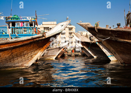Traditional Arabian boats or Dhows moored along the Dubai Creek in Deira, Old Dubai, United Arab Emirates, UAE - Stock Photo