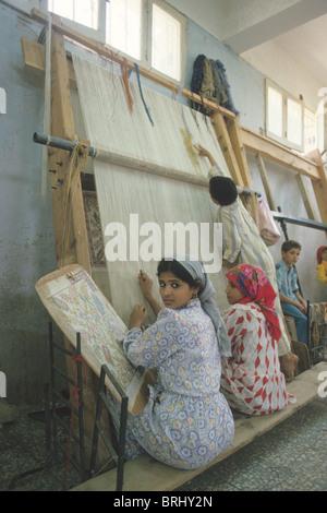 Egyptian rug weavers, near Cairo, Egypt. - Stock Photo