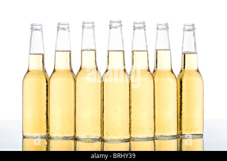 beer bottles with water droplets and reflection isolated on white - Stock Photo